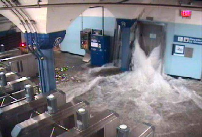 Floodwaters from Hurricane Sandy rush into the Port Authority Trans-Hudson's (PATH) Hoboken, New Jersey station through an elevator shaft